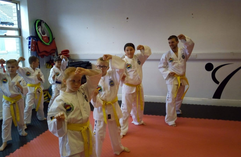 Students demonstrating Taekwondo patterns